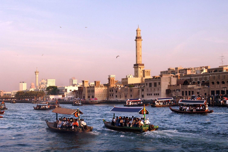 view of busy tourist abras on Dubai creek, toward the old mosque in Bur Dubai