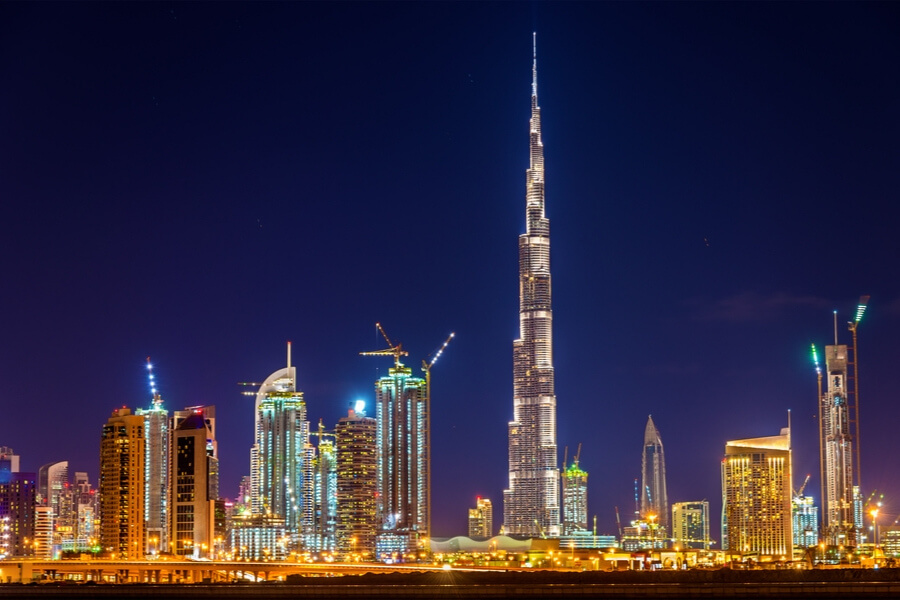 nightime view of the dubai city skyline centered around the Burj Khalifa