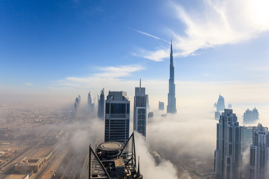 fog sitting over skyscrapers in downtown Dubai