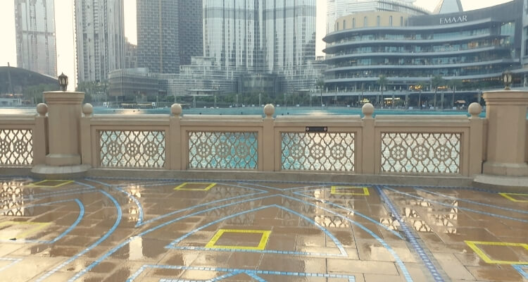 Line markings for social distancing around burj lake fountain show