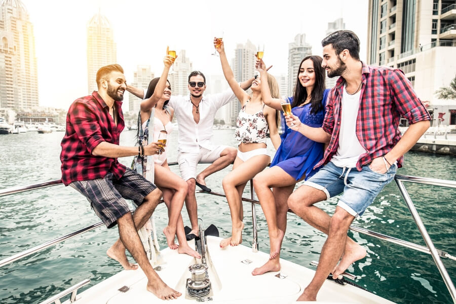 Group of friends drinking on a yacht Dubai Marina