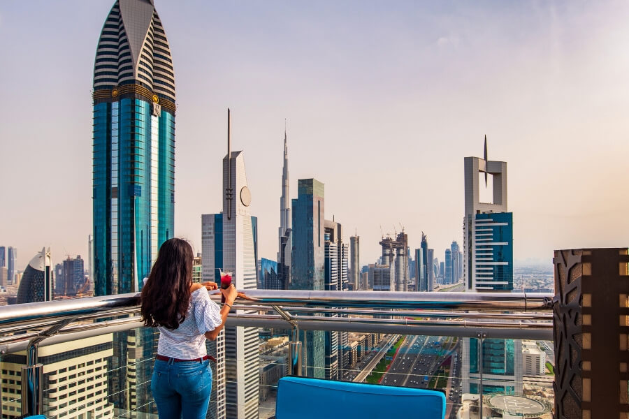 Lady with drink at Dubai Rooftop bar
