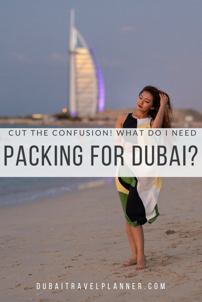 Lady on Dubai Beach in front of Burj Al Arab hotel, packing for Dubai advice for tourists