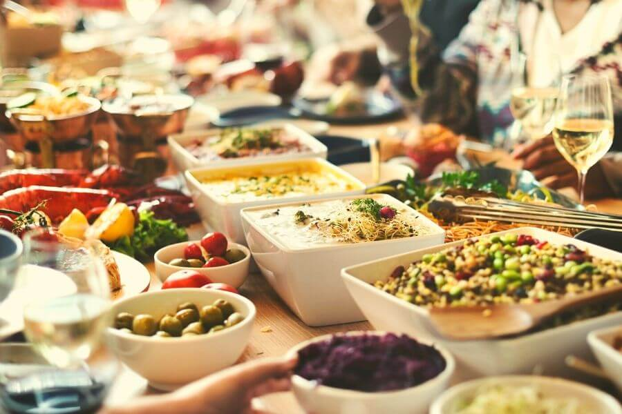 display of food on a long table - open buffet