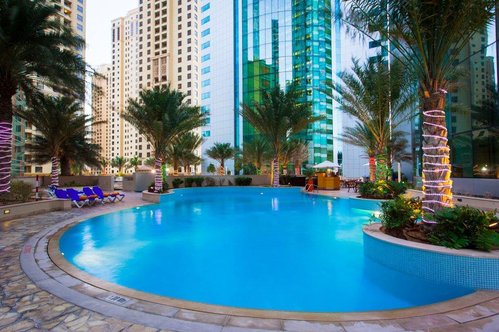 JA Oasis Beach Tower pool inbetween highrise towers