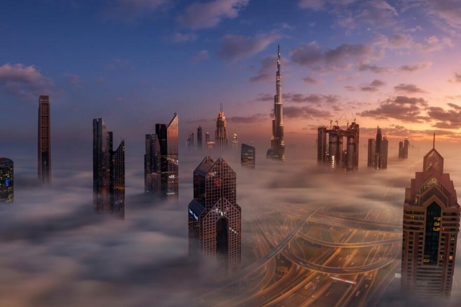 Dubai skyscrapers srouded in fog at dawn