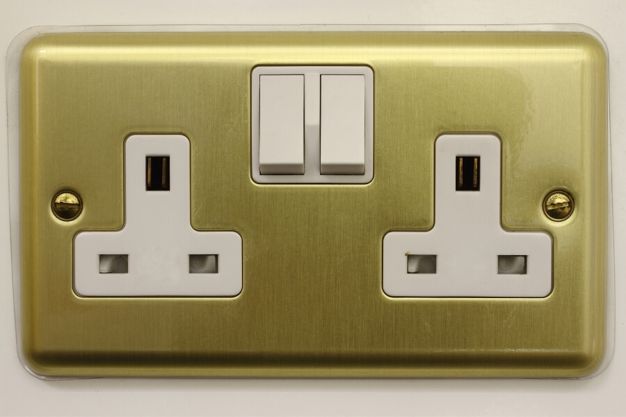 Type G sockets in Dubai gold and white