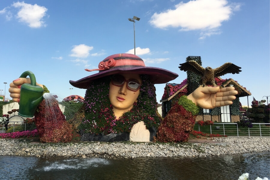 Dubai Miracle Garden - lady with watering can