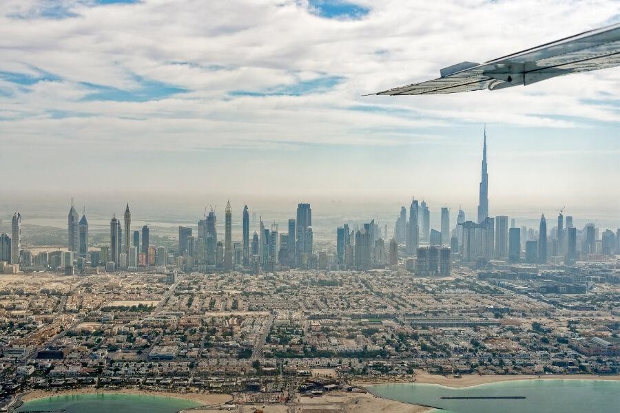 plane wing over the city of Dubai