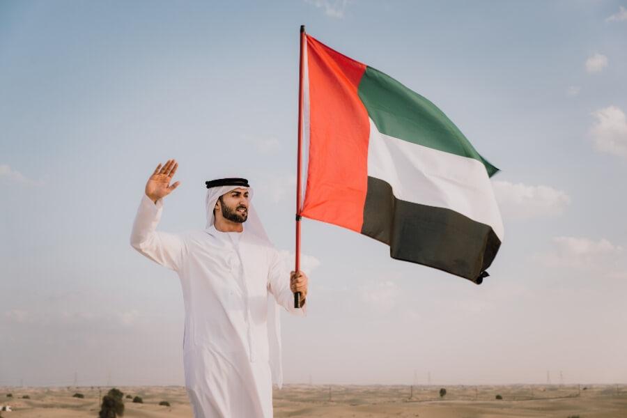 Man holding Emirati flag in Dubai