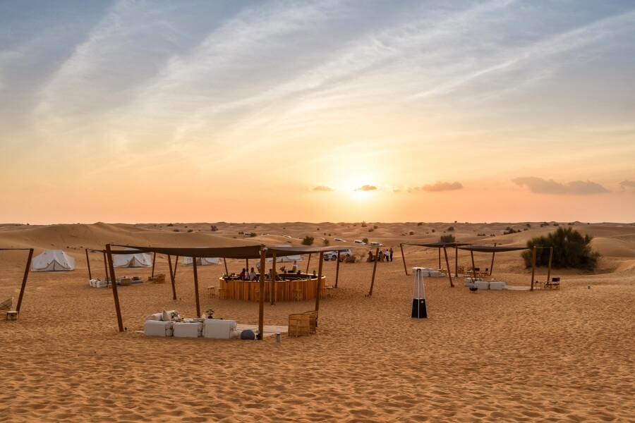 Sonara Desrt camp at sunset, dining and overnight camping tents in the Dubai Desert Conservation Reserve