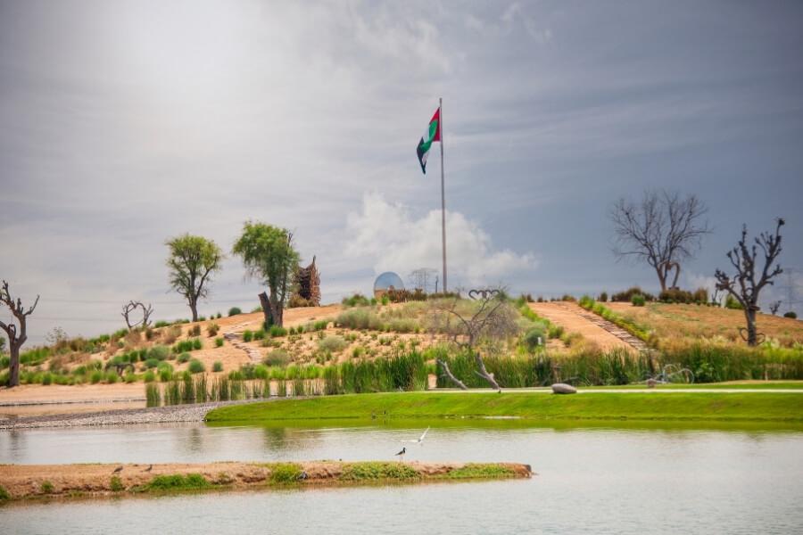 Love lake Dubai UAE flag on a hill