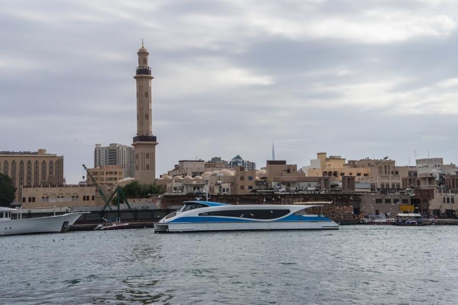 Dubai Ferry operating on Dubai Creek, Bur Dubai mosque in background