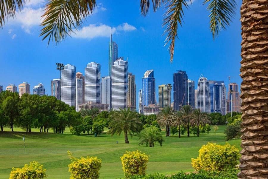 Golf course in Dubai with JLT and the Dubai marina skyscrapers as a back drop