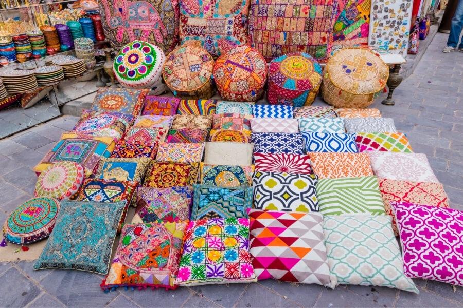 textiles for sale at a dubai textile souk stall